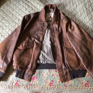 Large brown leather bomber jacket